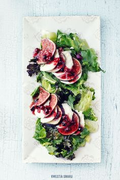 """Fig, mozzarella and cranberries """"caprese"""" style salad. Recipe is in Polish but thanks to google translate it is: Layer fresh sliced mozzarella and thinly sliced figs on lettuce and drizzle dressing on top (mix 2 tbsp cranberry preserves with whole cranberries, 1 tbsp honey, 2 tsp lemon juice, freshly ground black pepper)"""