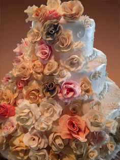 Wedding cake with cascade of flowers. Roses are gumpaste, all petals are hand-cut shaped and rolled, then colored!