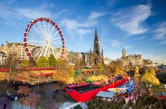 A view across Edinburgh and the Edinburgh Christmas festival, including ferris wheel and star flyer, in this ultimate guide to Edinburgh