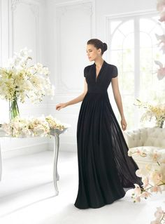 "Pronovias ""It's My Party"" by St. Patrick 5060- Black short-sleeve with lace back. Size available: 10"