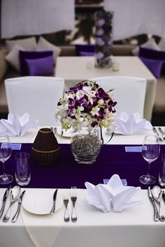 A gorgeous arrangements of local orchids in purple and white. A great use of flower to add colour to your wedding day. #HoiAnEventsWeddings #VietnamBeachWeddings
