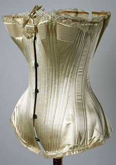 Corset   Date: mid-1880s Culture: American Medium: silk, cotton, metal Dimensions: Length at CB: 13 1/4 in. (33.7 cm)   the metropoltian museum of art
