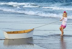 Girl with her boat on the beach in Palm Beach |Deborah Kalas Portrait Photography