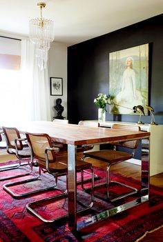 Design Crisis' own dining room, ebay rug, 70's caned chairs, chandelier, black glossy wall, console table