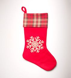 This lovely Red Snowflake Christmas Stocking features a white snowflake with a tartan trim at the top and a red loop to hang up as a decoration A