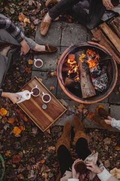 Fall inspiration and ideas. Hot chocolate by an outdoor bonfire surrounded by fall leaves and friends. Cozy sitting around a firepit in the backyard. Fall party and weekend ideas. Things to do during fall. Autumn Cozy, Fall Winter, Autumn Coffee, Autumn Tea, Autumn Feeling, Dark Autumn, Autumn Nature, Autumn Garden, Hello Autumn