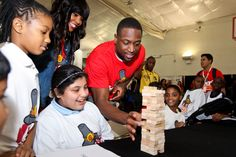 Dwyane Wade of the Miami Heat serves meals during the 2012 Heat Thanksgiving Celebration.