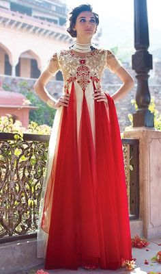 Give in to the exotic confluence of today & tomorrow in this cream and red embroidered net gown. The ethnic patch, resham and stones work over a attire adds a sign of attractiveness statement with your look. #NewEnigmaticPatternOfDesignerGown