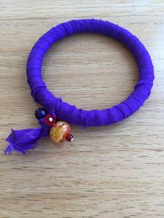 Bangle bracelet made with repurposed purple by DunroaminFarmDesign