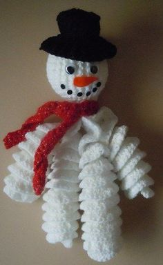 Crochet curly snowman Christmas ornament free pattern.