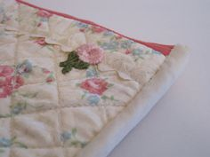 A purse or a bag to keep your treasures in.  Etsy listing at http://www.etsy.com/listing/150358205/vintage-floral-pouch