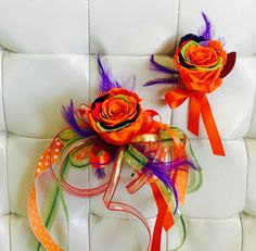 Rainbow orange roses are a hit embellished with ribbon tails and purple feathers. Perfect for that spark plug teen.