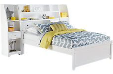 The Ivy League white twin bookcase bed with the storage piers added on the side from Rooms To Go Kids/Teens.