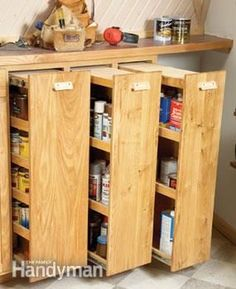 Workshop rollouts. But wait! Why not do these full height and make a pantry this way, too??? Perhaps with blackboard or whiteboard painted ends so they can have inventory listed. Different widths/depths for different stuff. So many possibilities. Now I'm imagining a whole kitchen's lower and floor-to-ceiling cupboards re-thought in a similar fashion. Or a bedroom or linen closet's folding-item shelves. Or...