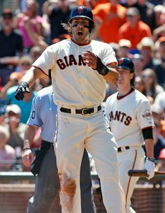 San Francisco Giants'  Michael Morse reacts after scoring against the Philadelphia Phillies during the second inning of a baseball game, Sunday, Aug. 17, 2014 in San Francisco. Giants pitcher Tim Lincecum is in the background. (AP Photo/George Nikitin)