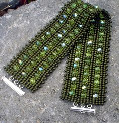 As with most of my beadwoven bracelets, this one is simple with a dash of sparkle. Matte Olive Toho seed beads and Fire-polished Czech glass