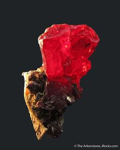 Proustite (dated 1827), Joachimstal, Ore Mountains region, Bohemia, Czech Republic, Thumbnail, 1.4 x 0.7 x 0.6 cm, A gorgeous, glowing, cherry red crystal when backlit, from this famous old mining district., For sale from The Arkenstone, www.iRocks.com. For more details on this piece and others, visit http://www.irocks.com/minerals/specimen/46113