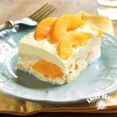 """Peaches and Cream Cake from Eagle Brand®. Have been making this since 2001 - can use drained can peaches (2 x   29 oz) patted dry and sliced as needed to be more """"uniform in size""""; can substitute 18oz CoolWhip for whipping cream. Is **even better when served the next day**!!  Holds shape perfectly when sliced for elegant presentation on dessert plate."""