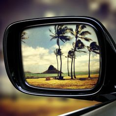 Chinaman's Hat in rear view mirror