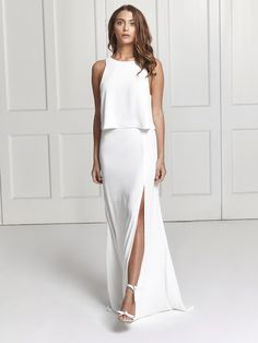 4f7fa23875 A white two piece set in deep red consisting of a racerback top and a floor  length skirt with a side slit.