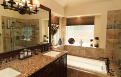 Kohler Soaking Tub Bathroom Traditional with Cherrywood Cabinets Floating Light Fixture Granite Vanity Top Kohler Soaking Tub Power