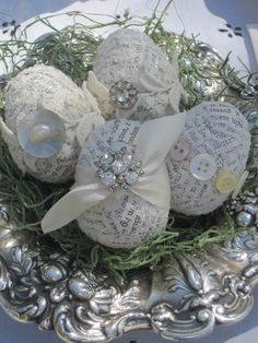 Cover plastic eggs with newspaper using modge podge then decorate with buttons, jewels, etc. OR try using vintage sheet music instead of newspaper. Egg Crafts, Easter Crafts, Easter Decor, Barn Crafts, Plate Crafts, Easter Ideas, Kids Crafts, Hoppy Easter, Easter Eggs