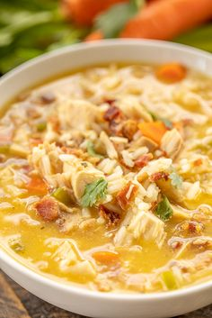 Crack Chicken and Rice Soup - this soup should come with a warning label! SO GOOD!!! Ready in 30 minutes! Chicken, cheese soup, chicken broth, celery, carrots, ranch mix, bacon, cheddar cheese and rice. Everyone went back for seconds - even our super picky eaters! A great kid-friendly dinner!! We love this soup! #soup #bacon #chickenandricesoup #crackchicken Soups With Chicken Broth, Soup Recipes With Chicken, Chicken Breast Soup Recipe, Recipe For Chicken Rice Soup, Recipes With Bacon Dinner, Crack Chicken Noodle Soup, Creamy Chicken Rice Soup, Carrot And Celery Recipes, Turkey Rice Soup