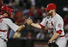 Boggs has lost weight too! Wow! --- St. Louis Cardinals' Mitchell Boggs, right, shakes hands with Yadier Molina after an MLB baseball game against the Arizona Diamondbacks Tuesday, April 2, 2013, in Phoenix. The Cardinals defeated the Diamondbacks 6-1. (AP Photo/Ross D. Franklin)