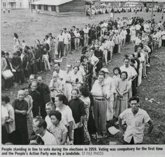 People standing in line to vote during the elections in 1959. Voting was compulsory  for the first time and the People's Action Party won by a landside.