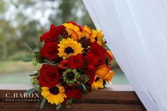Sunflower + maroon bouquet--the perfect fall wedding bouquet!  So elegant and love the fall colors!  Taken at THE SPRINGS in Katy.  Book your free tour today!  Photographer:  C. Baron Photography #fallwedding #fallbouquet #bouquet #sunflowers #sunflowerbouquet #fall