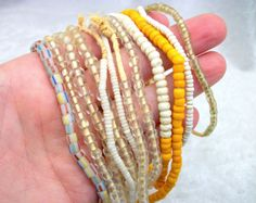 African Trade Bead Strands - Antique Glass - Clear White Yellow Striped