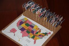 Use toothpicks to place flags in the right place on the map. Corkboard makes it stand.