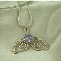 """wrapped using many feet of .935 Argentium and .999 Fine silver wire, both of which tarnish at a much slower rate than .925 sterling silver. The pendant measures 1 1/2"""" wide and 1"""" long. Included in your purchase is a .925 Sterling Silver snake chain which is 2mm thick and 18"""" long by Chained By Lightness $75"""