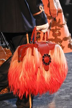 L. Vuitton - how fun, would be like carrying a muppet with you