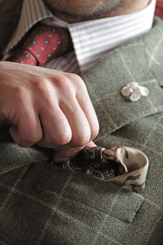 Great attention to detail: the patterns, textures, lapel pin, and a pocket square.