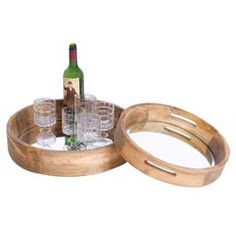 """Two mirrored trays with wood trim.   Product: Small and large trayConstruction Material: Wood and mirrored glassColor: Natural and silverDimensions: Small: 2.75"""" H x 15"""" Diameter  Large: 3.5"""" H x 17.5"""" Diameter Note: Glasses and bottle not included"""