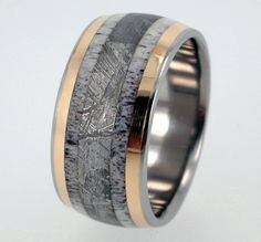 Really neat wedding ring for a man...   gold, deer antler and meteorite inlays are solid, with NO JOINTS and goes all the way around the Titanium Ring.