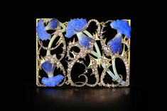 The spikes of this plant can't scare off the  vibrancy of the blue enamel.