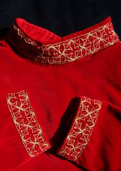 Gentlemen's red cotehardie Dress from the Bohemian Kingdom is made of a red velvet, gold embroidery and fur tippets. 2nd half of the 14th century.
