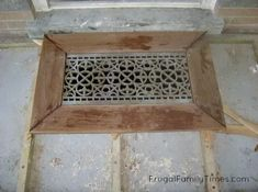 How to make a unique built-in welcome mat from a reclaimed iron grate. A great idea for your porch or deck - looks beautiful and is functional - helps keep your floors clean at the door! Ours is made from an antique floor gate from a greenhouse.