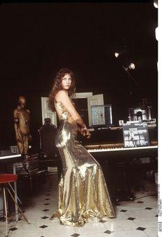 Jane Birkin in a gold sequin gown