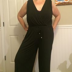 HP Black Jumpsuit Sleeveless black jumpsuit with drawstring and tie at the waist. Spense woman Other