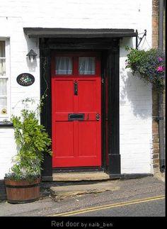 red door with black molding Red Door House, Interior Paint Colors For Living Room, Open Door Policy, Black Molding, Windows And Doors, Red Doors, Front Door Colors, Painted Doors, Home Decor Inspiration