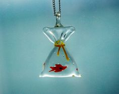 """A red gold fish swimming around inside a bag! This necklace is kitsch and whimsical, perfect for fish lovers.   The crystal clear glass pendant is 3x5.5cm in size and hangs from a 24"""" silver plated chain.  The length of the chain can be adjusted upon request.   Please read terms and conditions before purchase: http://www.etsy.com/shop/NaturalPrettyThings/policy  For custom item click here: http://www.etsy.com/conversations/new?with_id=17315786&subject=Custom+Item+Request   For other ..."""