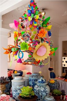 paper/fabric chandelier by artist Sue-Ching Lascelles at Black and Spiro -could be cute for a kid's room...maybe a mobile?