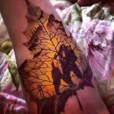 Awesome silhouette bear on a maple leaf tattoo