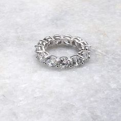 If you cant tell the difference between this ring and a real diamond ring, you will not be alone! This beautiful sterling silver anniversary band has been a best seller for over a year! Save money on wedding rings with this beautiful placeholder engagement ring and wedding band. #anniversaryband #weddingband #weddingring #engagementrings #replacementrings