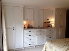 Wall unit for a couple who downsized and needed additional storage in their master bedroom.
