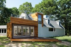 I love this clean, modern addition to an otherwise unremarkable exterior.
