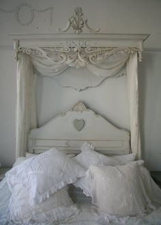 Antique headboard and fluffy pillows